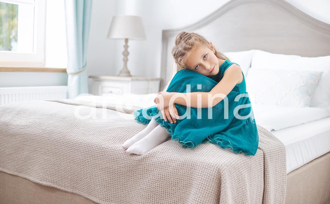 stockfresh_6559378_sad-young-girl-sitting-in-bedroom_sizeXL_84e148